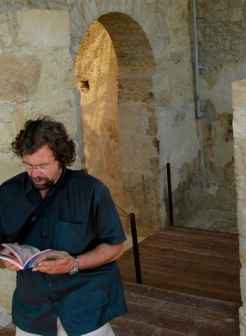 Nick studies our Cadogan Guide to Sicily